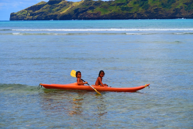 Anaho Beach children canoe Nuku Hiva Marquesas Islands French Polynesia
