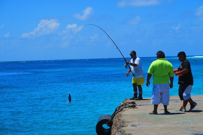 Fishing off the pier in Avatoru Village Rangiroa French Polynesia