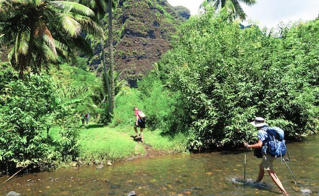 Hakaui Valley Vaipo Waterfall hike crossing river Nuku Hiva Marquesas Islands French Polynesia
