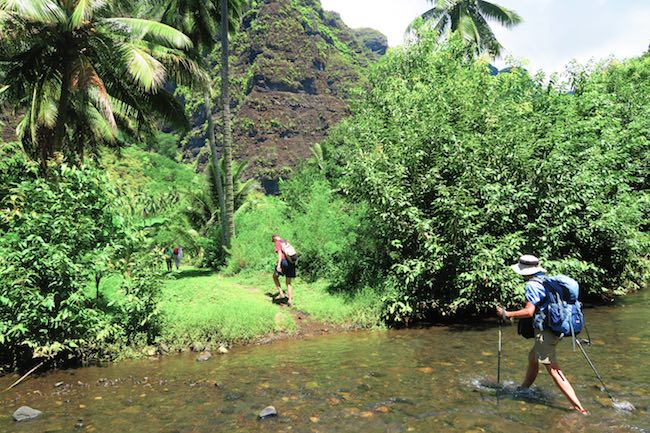 Hakaui Valley Vaipo Waterfall hike crossing river Nuku Hiva Marquesas Islands French Polynesia
