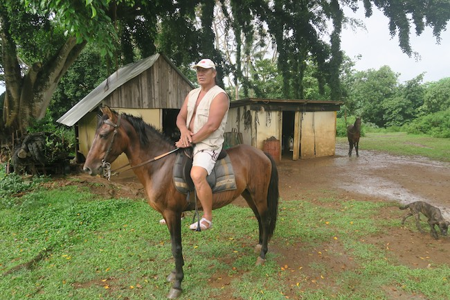 Horseback riding Hiva Oa Marquesas Islands French Polynesia Paco