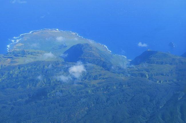 Kalaupapa Peninsula and Pali Coast from air - Molokai Hawaii