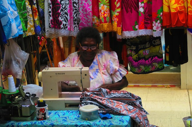 Local Woman Sewing In Hebrida Market Place - Port Vila, Vanuatu