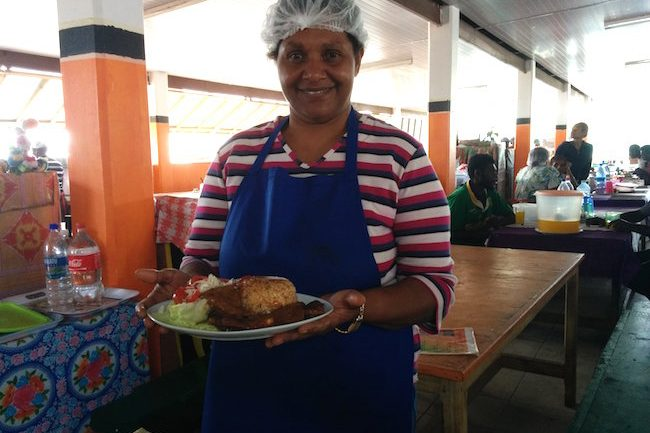Local Woman serving lunch in Lunch In Port Vila Central Market - Vanuatu
