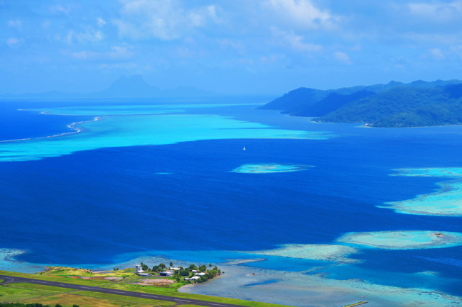Mount Tapioi hike panoramic view of Bora Bora and Tahaa Raiatea Island French Polynesia