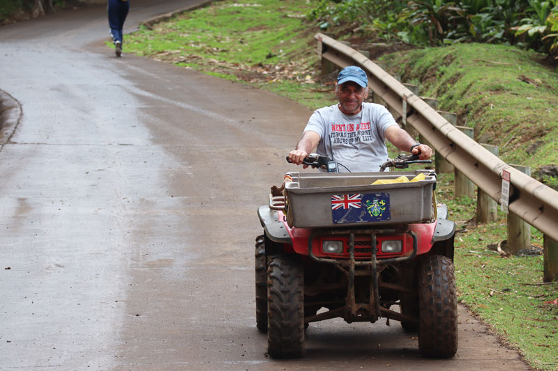 Pitcairn Island - local on ATV in hill of difficulty