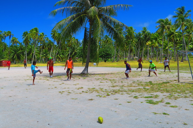 Tahitians playing soccer Rangiroa French Polynesia
