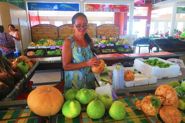 Uturoa Market Raiatea Island French Polynesia drinking coconut
