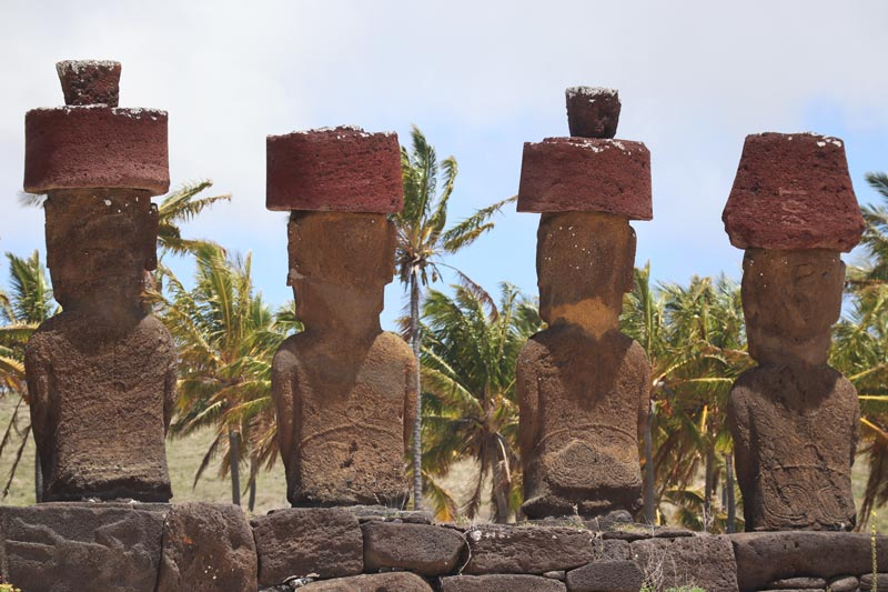 decorated backs of moai in Ahu Nau Nau - Easter Island