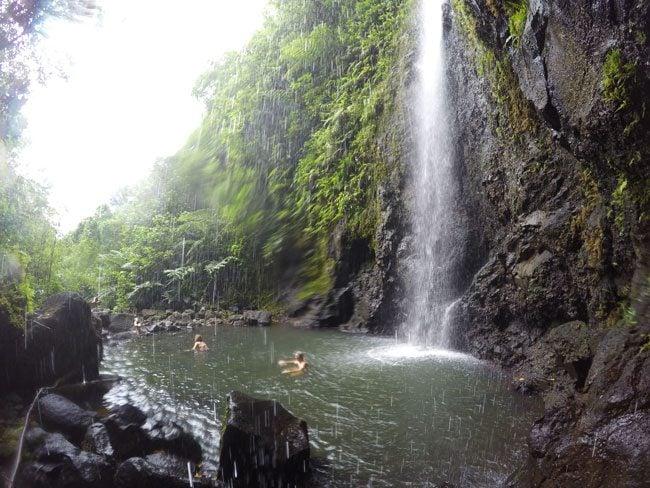 les trois cascades three waterfalls Raiatea Island French Polynesia behind waterfall