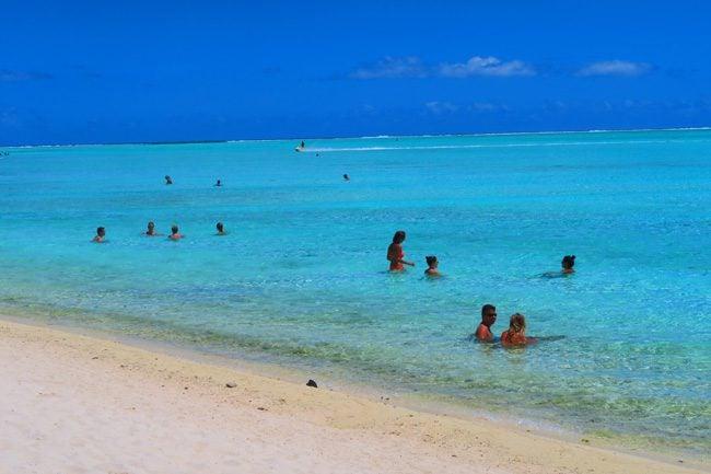 matira beach bora bora french polynesia people in water