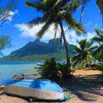 mountain and boat on beach in bora bora french polynesia