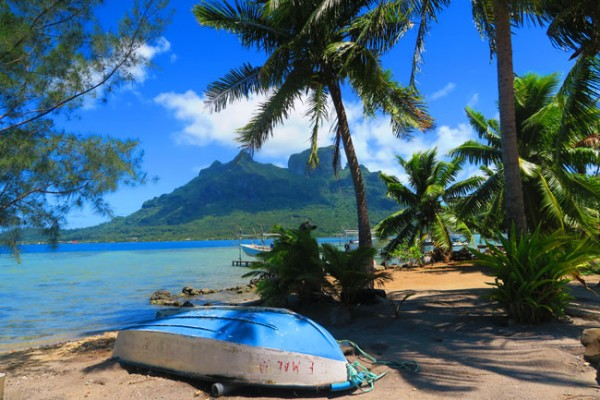 mountain and boat on beach in bora bora french polynesia