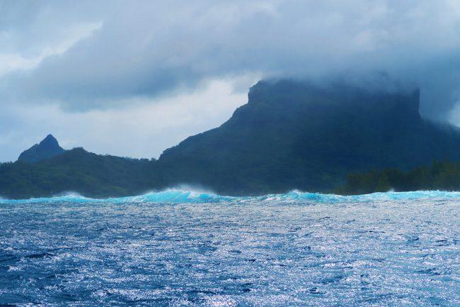 waves outside lagoon in bora bora french polynesia