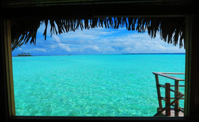 window overlooking blue lagoon le tahaa luxury resort french polynesia