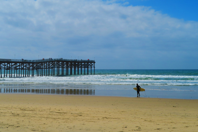 Pacific Beach Pier and surfer