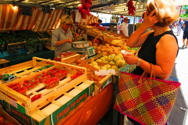 Buying food at Edgar Quinet Market Paris