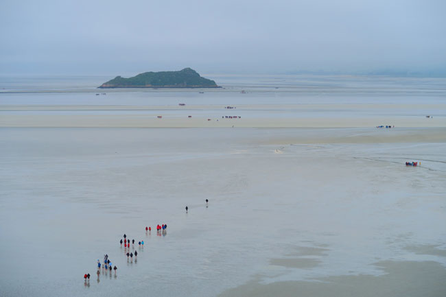 people walking to mont saint michel