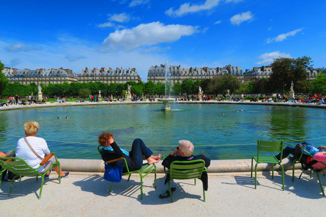 Tuileries Gardens Paris relaxing on chairs