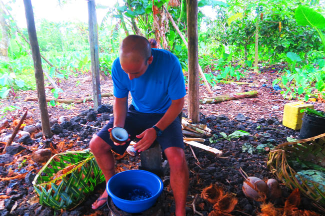 Making Umu in Samoa scraping coconuts