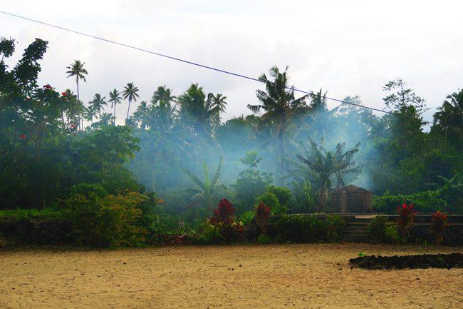 Making Umu in Samoa smoke from fire