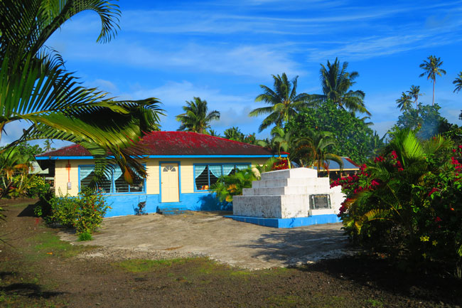 Savaia Traditional Samoan home with grave