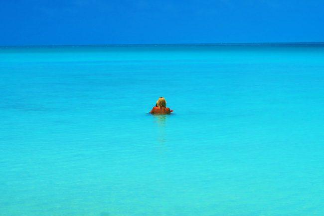 Akaiami Island Aitutaki couple in tropical water
