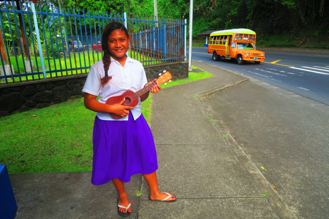 Girl playing ukelele in Pago Pago American Samoa