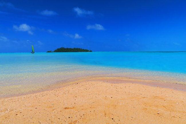 Sandy dune in Motu Rakau tropical island Aitutaki