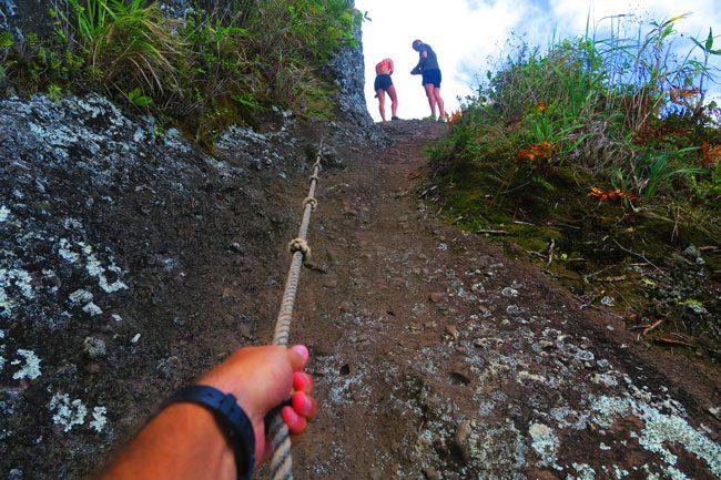 Cross Island Track Rarotonga Cook Islands climbing to needle with rope