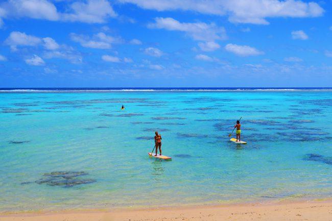 Paddling in Rarotonga Cook Islands paddlers in water