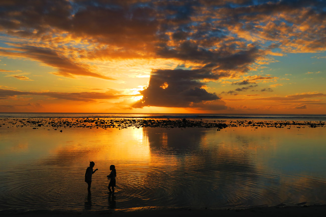Sunset in Rarotonga Cook Islands children playing