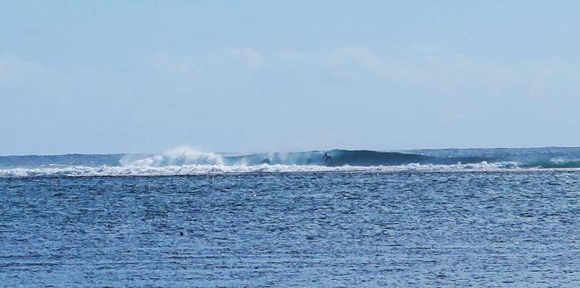 Surfer in Teahupoo Beach Tahiti French Polynesia