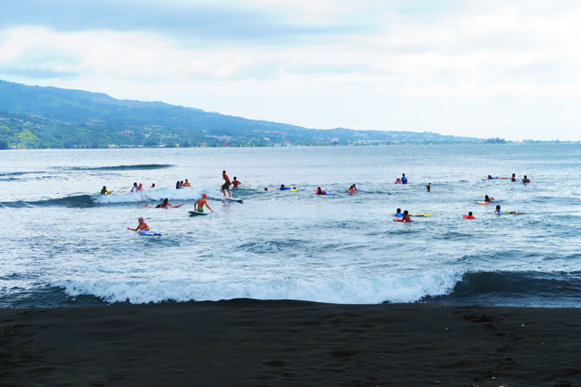 Surfers at pointe venus beach Tahiti French Polynesia