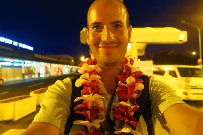 Tahitian flower necklace at airport