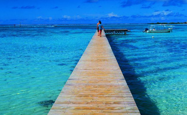 Motu beach Les Tipaniers Moorea French Polynesia pier