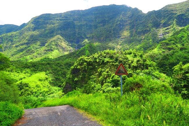 Papenoo valley Tahiti waterfall and steep road sign