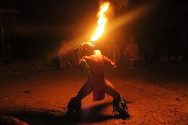 Tiki Village Moorea fire show licking fire