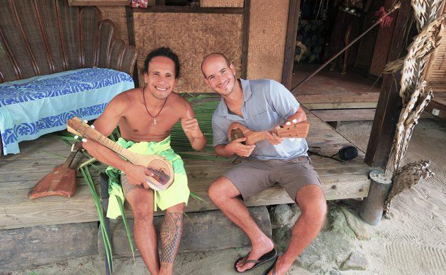Tiki Village Moorea playing ukelele