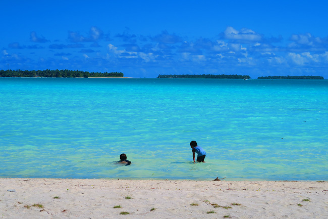 Airport in Maupiti French Polynesia children playing in beach