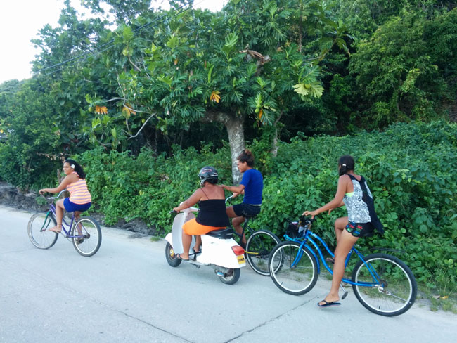 Islanders riding bike in Maupiti French Polynesia