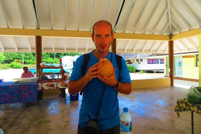 Maupiti market drinking coconut
