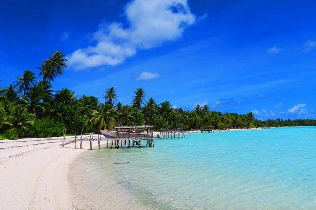 Motu Auira Maupiti French Polynesia pristine beach with boats