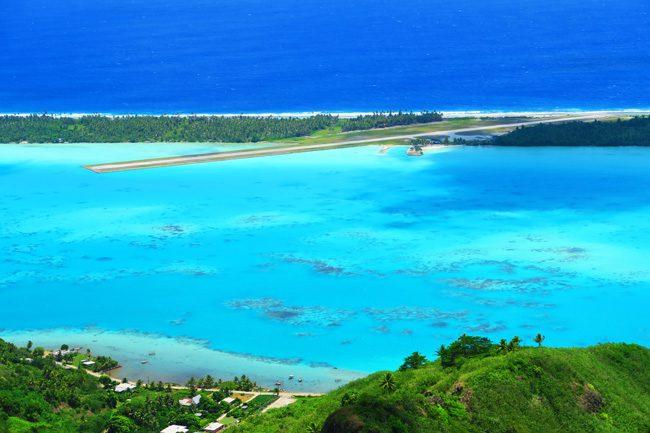 Mount Teurafaatiu view of Maupiti airport on motu