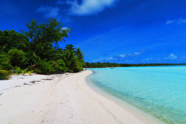 Pristine tropical beach in Motu Auira Maupiti French Polynesia