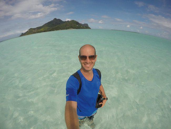 Walking towards Motu Auira Maupiti French Polynesia