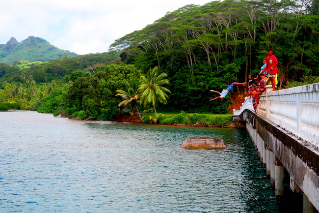 jumping from Huahine bridge French Polynesia