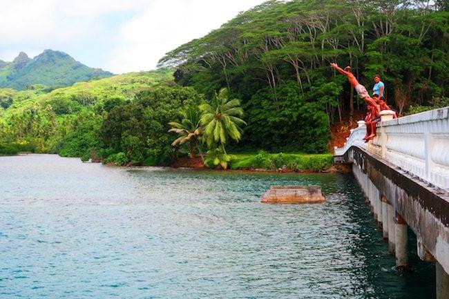 jumping off bridge Huahine Island French Polynesia