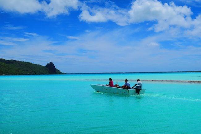 Locals in boat Maupiti French Polynesia