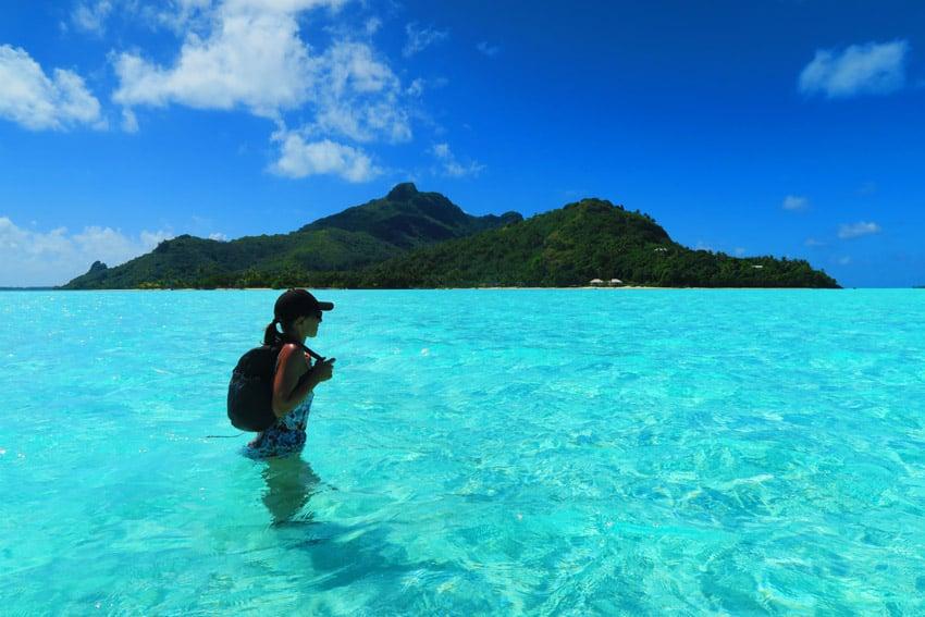 Motu Auira Maupiti French Polynesia - crossing lagoon on foot